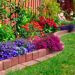 Border Backyard Flower Bed with Brick Wall